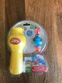 Twirlywoos flying toy, brand new in packaging.