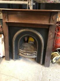Cast fire place and wooden surround