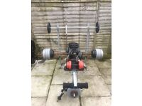 Weights bench and 144kg of plates and various bars