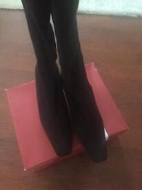 Black mid heel knee high boots with stretch to leg for comfort,new and boxed