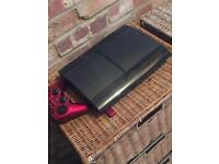 Super slim PS3 console, games and cables