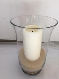 Hurricane vase, sand and candle