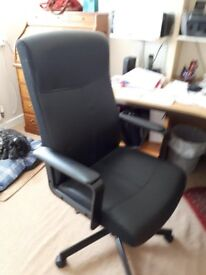 Black office swivel chair with arms