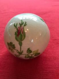 Rose ceramic globe.