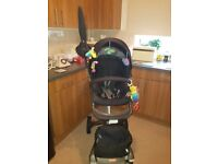 Stokke v4 stroller buggy for sale including carrying cot very good condition cost £1200