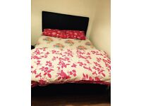 King size bed for sale with two draws leather headboard purchased from dreams. Strong quality