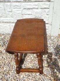 Small dark wood/oak drop leaf side table