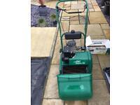 suffolk punch 14s petrol lawn mower with scarifier