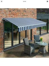 3.5m x 2.5m blue and white awning (fixings and winding arm missing)