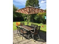 Large garden table with parasol and 6 chairs