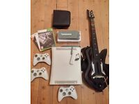 Xbox 360 console, 3 wireless controllers, guitar hero wireless controller, 40 games and extras