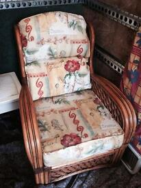 Two wicker style chairs