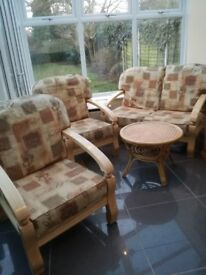 Three piece conservatory suite with matching coffee table, in excellent condition.