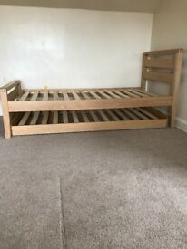 Single trundle pull out bed frame