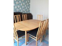 Dining table with six chairs in good condition plus extension piece