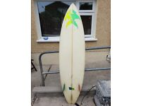 Triple fin surf bord 6ft 6in with leash £75 ono also Tiki foam board 7ft 6in £50ono ready to surf