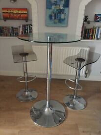 Small glass table and two bar stools