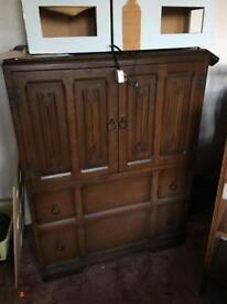 Old charm oak linen fold design tall boy