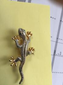 Gold and silver coloured lizard brooch