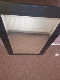 Black glossy glass mirror