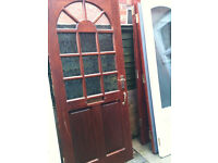 Exterior hardwood door with frosted glass panels