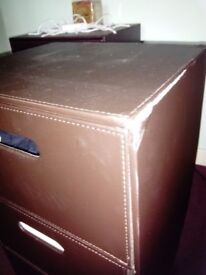 One Faux leather bedside cabinet