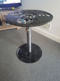 Bespoke garden table, hand made from motorcycle chains and sprockets.