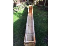 REDUCED - Very long solid wooden garden trough / planter on legs, would look great painted up