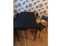 Dining table and 4 chairs black
