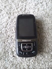Samsung mobile phone slider style, no charger. Has camera and games etc.