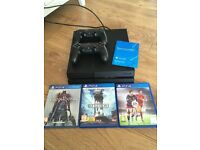 Playstation 4 with 2 controllers 3 games