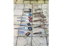 Job lot of garden tools, chainsaws, garden trimmer, saws and hand tools.