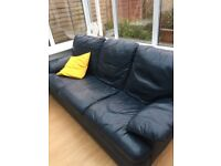 Two Navy leather sofas. Two seater and a three seater.