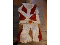 Elvis costume (Brand new) size Large to X large.