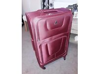 2 large suitcases with wheels, used once