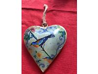 Bird tin heart decoration.