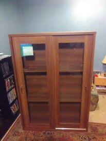 Shelf unit with glass sliding doors