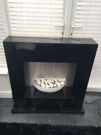 Next Black Gloss Electric Fireplace with White Pebbles