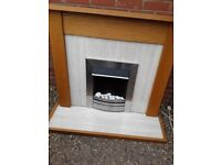 Wooden fire surround with electric fire