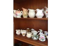 A collection of cream/milk jugs mostly bone China