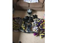 Motocross gear, trousers, top, boots, gloves, hat and armour.