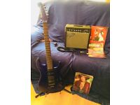 Electric guitar and fender amp with books