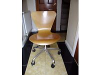 Wooden swivel chair and blue swivel chair