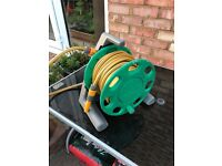 Water hose with reel, few years old but hardly been used, in very good condition collection only