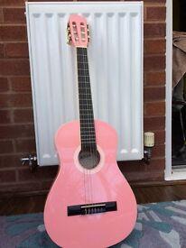 Pink Ashton guitar with black Ashton case