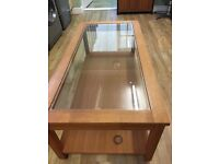 Wooden coffee table with glass inlay
