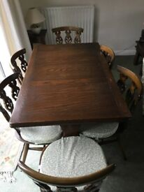 Ercol solid oak dining room table and 6 chairs