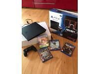 PS4 console, wireless controller & 4 games