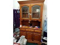 Dresser with glass doors.