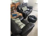 Leather two seater sofa and arm chair